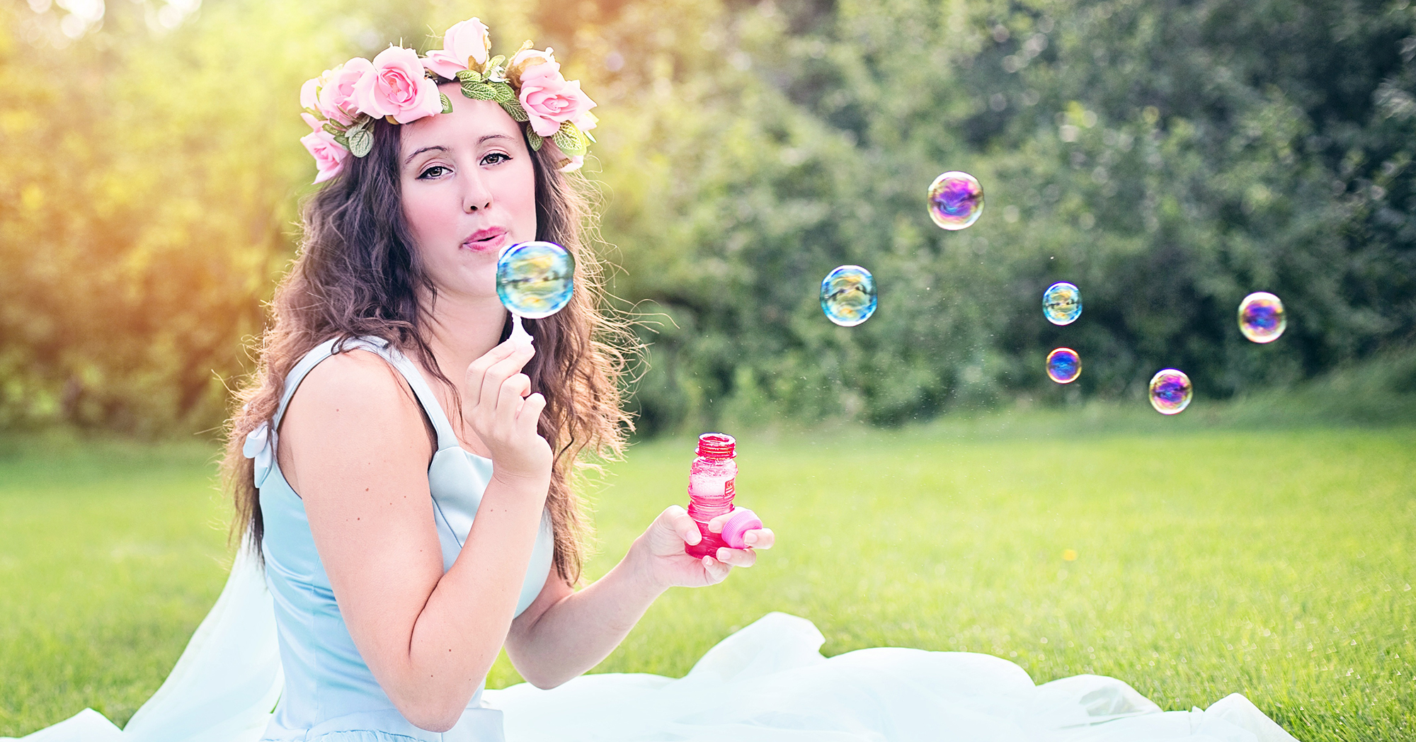 woman-blowing-bubbles-young-sitting